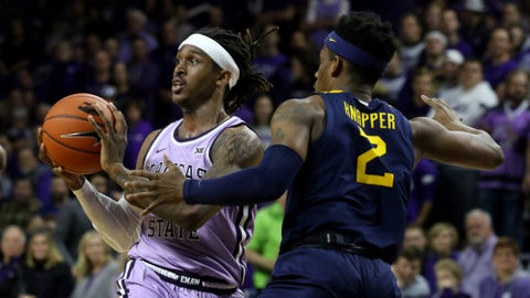 Jan 18, 2020; Manhattan, Kansas, USA; Kansas State Wildcats guard Cartier Diarra (2) passes the ball while guarded agains tWest Virginia Mountaineers guard Brandon Knapper (2) during the first half of a game at Bramlage Coliseum. Mandatory Credit: Scott Sewell-USA TODAY Sports