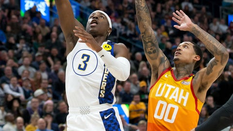 Jan 20, 2020; Salt Lake City, Utah, USA; Indiana Pacers guard Aaron Holiday (3) shoots the ball against Utah Jazz guard Jordan Clarkson (00) during the first half at Vivint Smart Home Arena. Mandatory Credit: Russell Isabella-USA TODAY Sports