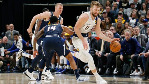 Jan 2, 2020; Indianapolis, Indiana, USA; Indiana Pacers forward Domantas Sabonis (11) is fouled by Denver Nuggets forward Gary Harris (14) during the third quarter at Bankers Life Fieldhouse. Mandatory Credit: Brian Spurlock-USA TODAY Sports