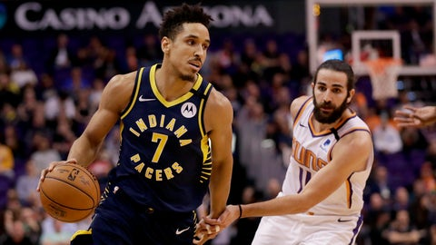 Indiana Pacers guard Malcolm Brogdon (7) drives past Phoenix Suns guard Ricky Rubio (11) during the first half of an NBA basketball game, Wednesday, Jan. 22, 2020, in Phoenix. (AP Photo/Matt York)