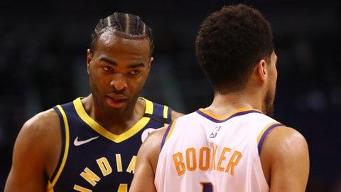 Jan 22, 2020; Phoenix, Arizona, USA; Phoenix Suns guard Devin Booker (right) bumps shoulders with Indiana Pacers forward T.J. Warren in the first half at Talking Stick Resort Arena. Mandatory Credit: Mark J. Rebilas-USA TODAY Sports