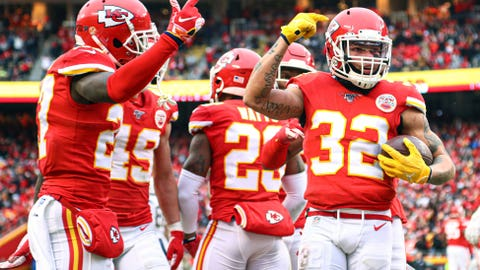 Dec 29, 2019; Kansas City, Missouri, USA; Kansas City Chiefs strong safety Tyrann Mathieu (32) celebrates with teammates after intercepting a pass against the Los Angeles Chargers during the first half at Arrowhead Stadium. Mandatory Credit: Jay Biggerstaff-USA TODAY Sports