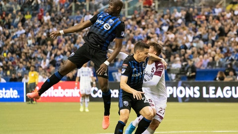 <p>               Montreal Impact's Rod Fanni heads the ball away from Deportivo Saprissa forward Manfred Ugalde (27) as defender Jukka Raitala covers during the first half of a CONCACAF Champions League soccer match Wednesday, Feb. 26, 2020 in Montreal. (Paul Chiasson/The Canadian Press via AP)             </p>