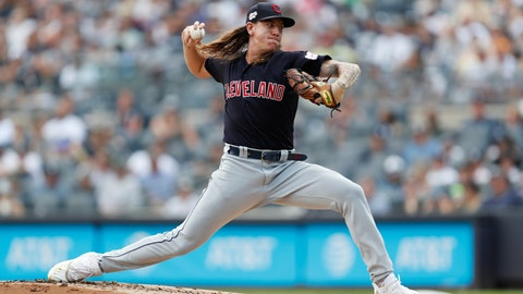 <p>               FILE - In this Aug. 18, 2019, file photo, Cleveland Indians' starting pitcher Mike Clevinger winds up during the first inning of a baseball game against the New York Yankees, in New York. Clevinger will undergo left knee surgery after injuring himself during a spring training workout. The team said Friday, Feb. 14, 2020, that Clevinger, who went 13-4 last season, suffered a partial tear of meniscus during a workout at the team's complex in Goodyear, Arizona on Wednesday.(AP Photo/Kathy Willens, File)             </p>