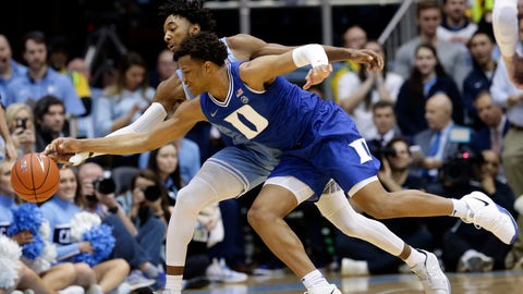 <p>               North Carolina guard Leaky Black, rear, and Duke forward Wendell Moore Jr. reach for a loose ball during the first half of an NCAA college basketball game in Chapel Hill, N.C., Saturday, Feb. 8, 2020. (AP Photo/Gerry Broome)             </p>