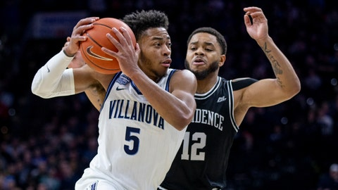 <p>               Villanova guard Justin Moore (5) moves past Providence guard Luwane Pipkins (12) during the first half of an NCAA college basketball game, Saturday, Feb. 29, 2020, in Philadelphia, Pa. (AP Photo/Laurence Kesterson)             </p>