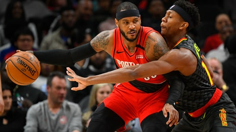 <p>               Portland Trail Blazers forward Carmelo Anthony, left, tries to keep the ball from Atlanta Hawks forward De'Andre Hunter during the first half of an NBA basketball game Saturday, Feb. 29, 2020, in Atlanta. (AP Photo/John Amis)             </p>