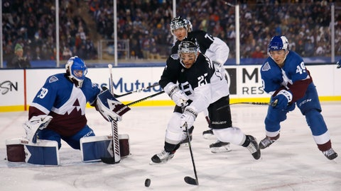 <p>               Los Angeles Kings defenseman Alec Martinez, center, looks to redirect the puck, between Colorado Avalanche goaltender Pavel Francouz, left, and defenseman Samuel Girard during the third period of an NHL hockey game Saturday, Feb. 15, 2020, at Air Force Academy, Colo. The Kings won 3-1. (AP Photo/David Zalubows             </p>