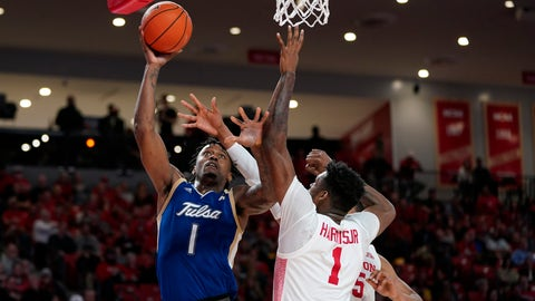 <p>               Tulsa's Martins Igbanu, left, goes up for a shot as Houston's Chris Harris Jr., center, and Fabian White Jr., right, defend during the second half of an NCAA college basketball game Wednesday, Feb. 19, 2020, in Houston. (AP Photo/David J. Phillip)             </p>