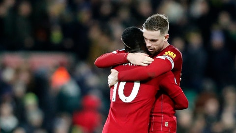 <p>               Liverpool's Sadio Mane, left, and Liverpool's Jordan Henderson celebrate at the end of the English Premier League soccer match between Norwich City and Liverpool at Carrow Road Stadium in Norwich, England, Saturday, Feb. 15, 2020. (AP Photo/Frank Augstein)             </p>