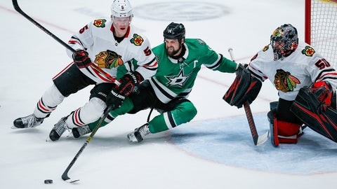 <p>               Dallas Stars forward Tyler Seguin (91) reaches for the puck as Chicago Blackhawks defenseman Connor Murphy (5) and goaltender Corey Crawford (50) defend during the second period of an NHL hockey game, Sunday, Feb. 23, 2020, in Dallas. (AP Photo/Brandon Wade)             </p>
