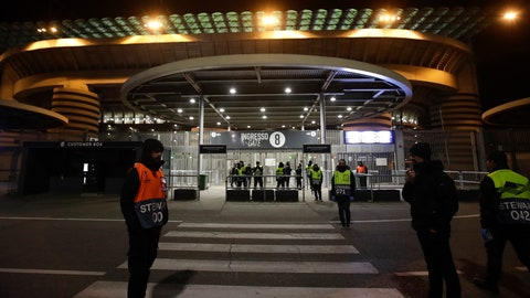 <p>               Stewards stand at a gate of the San Siro stadium in Milan, Italy, Thursday, Feb. 27, 2020. Ludogorets is playing Italian club Inter Milan in a Europa League soccer match on Thursday that is scheduled to go ahead in an empty stadium due to the coronavirus outbreak. (AP Photo/Luca Bruno)             </p>