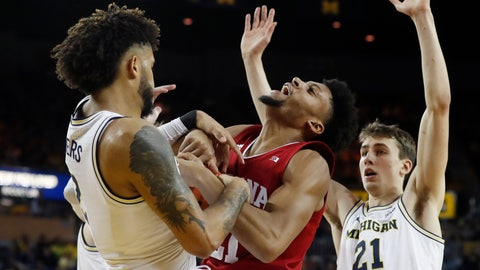 <p>               Indiana forward Jerome Hunter, center, and Michigan forward Isaiah Livers, left, fight for the rebound during the first half of an NCAA college basketball game, Sunday, Feb. 16, 2020, in Ann Arbor, Mich. (AP Photo/Carlos Osorio)             </p>