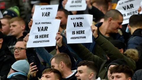 <p>               Fans hold banners against Video Assistant Referee (VAR) during the English Premier League soccer match between Manchester City and Crystal Palace at Etihad stadium in Manchester, England, Saturday, Jan. 18, 2020. (AP Photo/Rui Vieira)             </p>