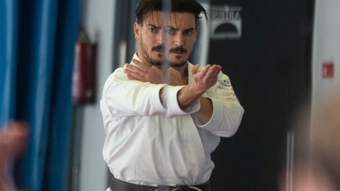 <p>               Spanish karate athlete Damian Quinteros is reflected in a large mirror as he trains in Madrid, Spain, Friday, Feb. 7, 2020. More than five years ago, one of Spain's most successful karate athletes was splitting his time between practice, school and his day job as an aeronautical engineer. Now, nearly five months before the Tokyo Games, Quintero is a full-time karateka and a top contender for the gold medal in Japan. (AP Photo/Paul White)             </p>