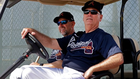 <p>               Atlanta Braves manager Brian Snitker, right, and bench coach Walt Weiss watch from a golf cart as the pitchers and catchers get loose during spring training baseball camp Thursday, Feb. 13, 2020, in North Port, Fla. (AP Photo/John Bazemore)             </p>