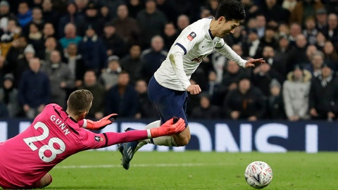 <p>               Southampton's goalkeeper Angus Gunn fouls Tottenham's Son Heung-min, right, in the box to give away a penalty shot during the English FA Cup fourth round replay soccer match between Tottenham Hotspur and Southampton at the Tottenham Hotspur Stadium in London, Wednesday, Feb. 5, 2020. (AP Photo/Kirsty Wigglesworth)             </p>