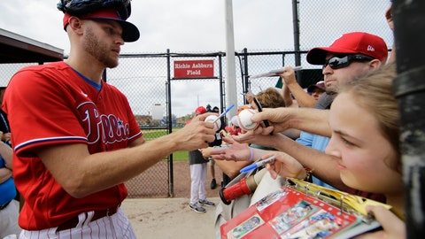 <p>               Philadelphia Phillies Zack Wheeler, left, signs autographs during a spring training baseball workout Friday, Feb. 14, 2020, in Clearwater, Fla. (AP Photo/Frank Franklin II)             </p>
