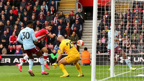 <p>               Southampton's Shane Long, second left, scores his side's first goal of the game against Aston Villa during their English Premier League soccer match at St Mary's Southampton, England, Saturday Feb. 22, 2020. (Mark Kerton/PA via AP)             </p>