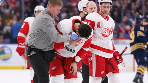 <p>               Detroit Red Wings forward Brendan Perlini (29) is helped off the ice by trainer and forward Dylan Larkin (71) during the first period of an NHL hockey game against the Buffalo Sabres, Tuesday, Feb. 11, 2020, in Buffalo, N.Y. (AP Photo/Jeffrey T. Barnes)             </p>