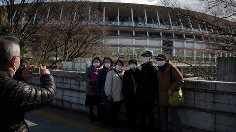 <p>               Tourists wear masks as they pause for photos with the New National Stadium, a venue for the opening and closing ceremonies at the Tokyo 2020 Olympics, Sunday, Feb. 23, 2020, in Tokyo. (AP Photo/Jae C. Hong)             </p>