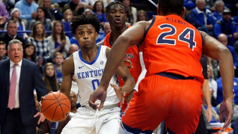 <p>               Kentucky's Ashton Hagans, left, looks for an opening against Auburn's Anfernee McLemore (24) during the first half of an NCAA college basketball game in Lexington, Ky., Saturday, Feb. 29, 2020. (AP Photo/James Crisp)             </p>