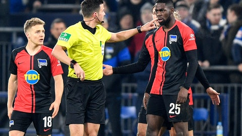 <p>               Referee Harm Osmers showed the red card to Berlin's Jordan Torunarigha, right, during the German soccer cup, DFB Pokal, match between FC Schalke 04 and Hertha BSC Berlin in Gelsenkirchen, Germany, Tuesday, Feb. 4, 2020. (AP Photo/Martin Meissner)             </p>