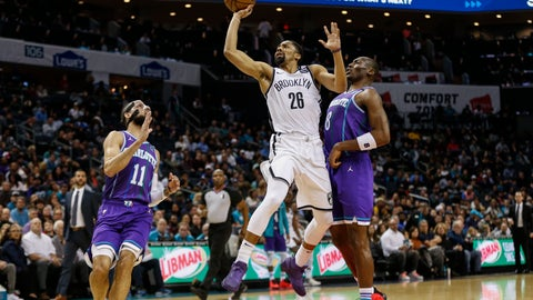 <p>               Brooklyn Nets guard Spencer Dinwiddie, center, shoots between Charlotte Hornets forward Cody Martin (11) and Charlotte Hornets center Bismack Biyombo (8) in the first half of an NBA basketball game in Charlotte, N.C., Saturday, Feb. 22, 2020. (AP Photo/Nell Redmond)             </p>