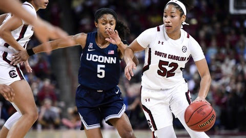 <p>               South Carolina guard Tyasha Harris (52) dribbles against Connecticut guard Crystal Dangerfield (5) during the first half of an NCAA college basketball game Monday, Feb. 10, 2020, in Columbia, S.C. (AP Photo/Sean Rayford)             </p>