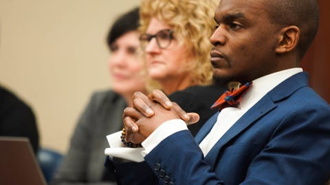 <p>               Defense attorney Takura Nyamfukudza listens to opening statements from the prosecution during the trial of ex-MSU gymnastics coach Kathie Klages Tuesday, Feb. 11, 2020,  at Veterans Memorial Courthouse in Lansing, Mich.  Klages is charged with lying to investigators in connection with sexual assault complaints against sports doctor Larry Nassar. (Anntaninna Biondo /Lansing State Journal via AP)             </p>