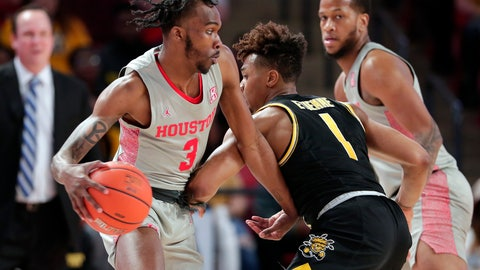 <p>               Houston guard DeJon Jarreau (3) drives around Wichita State guard Tyson Etienne (1) during the first half of an NCAA college basketball game Sunday, Feb. 9, 2020, in Houston. (AP Photo/Michael Wyke)             </p>
