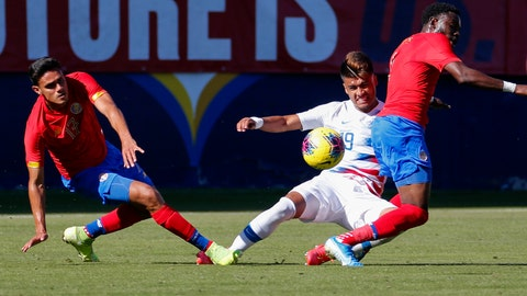 <p>               United States forward Ulysses Llanez, center, slides between Costa Rica midfielder Yeltsin Tejeda, left, and defender Keysher Fuller (4) during the first half of an international friendly soccer match in Carson, Calif., Saturday, Feb. 1, 2020. (AP Photo/Ringo H.W. Chiu)             </p>