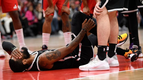 <p>               Brooklyn Nets guard Kyrie Irving reacts after he was injured during the second half of an NBA basketball game against the Washington Wizards, Saturday, Feb. 1, 2020, in Washington. (AP Photo/Nick Wass)             </p>