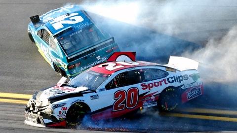 <p>               Erik Jones (20) and Kyle Larson (42) wreck going through Turn 4 during the NASCAR Busch Clash auto race at Daytona International Speedway, Sunday, Feb. 9, 2020, in Daytona Beach, Fla. (AP Photo/Darryl Graham)             </p>