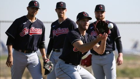 <p>               Cleveland Indians pitcher Kyle Dowdy, front, fields a grounder as pitchers Carlos Carrasco, left, Shane Bieber, middle, and Logan Allen, right, look on during spring training baseball workouts for pitchers and catchers Thursday, Feb. 13, 2020, in Avondale, Ariz. (AP Photo/Ross D. Franklin)             </p>