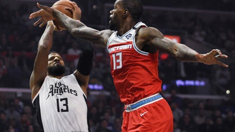 <p>               Los Angeles Clippers guard Paul George, left, shoots while Sacramento Kings center Dewayne Dedmon defends during the first half of an NBA basketball game in Los Angeles, Thursday, Jan. 30, 2020. (AP Photo/Kelvin Kuo)             </p>