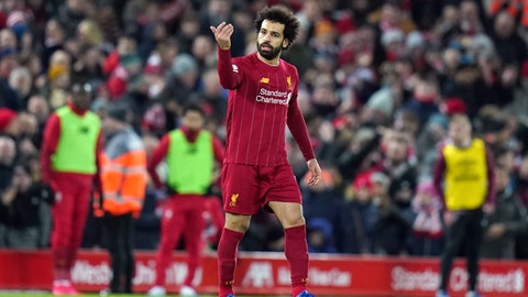 <p>               Liverpool's Mohamed Salah reacts after scoring his team's second goal during the English Premier League soccer match between Liverpool and West Ham at Anfield Stadium in Liverpool, England, Monday, Feb. 24, 2020. (AP Photo/Jon Super)             </p>