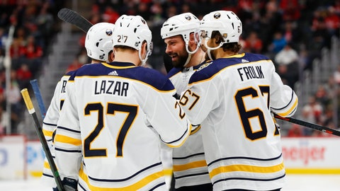 <p>               Buffalo Sabres defenseman Zach Bogosian, second from right, celebrates his goal with teammates in the third period of an NHL hockey game against the Detroit Red Wings, Sunday, Jan. 12, 2020, in Detroit. (AP Photo/Paul Sancya)             </p>