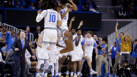 <p>               UCLA guard Chris Smith (5) celebrates with guard Tyger Campbell after scoring during the second half of the team's NCAA college basketball game against Washington in Los Angeles, Saturday, Feb. 15, 2020. (AP Photo/Chris Carlson)             </p>