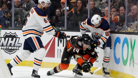 <p>               Anaheim Ducks center Carter Rowney goes after the puck between Edmonton Oilers defenseman Adam Larsson, left, and defenseman Caleb Jones during the second period of an NHL hockey game in Anaheim, Calif., Tuesday, Feb. 25, 2020. (AP Photo/Chris Carlson)             </p>