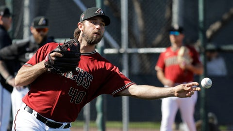 <p>               Arizona Diamondbacks' Madison Bumgarner throws during spring training baseball practice, Sunday, Feb. 16, 2020, in Scottsdale, Ariz. (AP Photo/Darron Cummings)             </p>