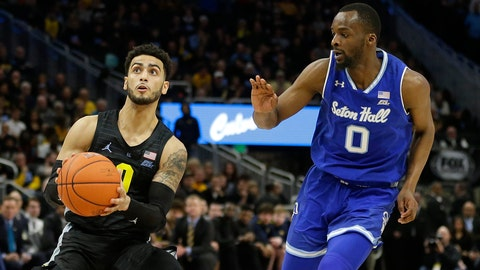 <p>               Marquette's Markus Howard, left, drives to the basket against Seton Hall's Quincy McKnight during the first half of an NCAA college basketball game Saturday, Feb. 29, 2020, in Milwaukee. (AP Photo/Aaron Gash)             </p>