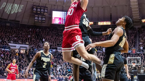 <p>               Indiana forward Joey Brunk (50) shoots at the basket as Purdue forward Trevion Williams (50) tries to block his shot during the first half of an NCAA college basketball game Thursday, Feb. 27, 2020, in West Lafayette, Ind. (AP Photo/Doug McSchooler)             </p>