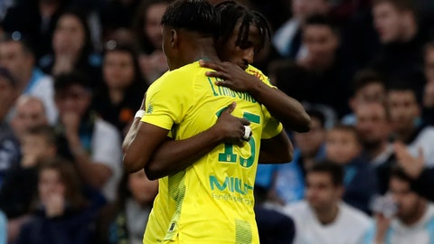 <p>               Nantes' Anthony Limbombe celebrates with teammate after he scored his side's opening goal during the French League One soccer match between Marseille and Nantes at the Stade Velodrome in Marseille, southern France, Sunday Feb. 22, 2020. (AP Photo/Daniel Cole)             </p>