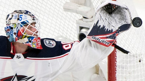 <p>               Columbus Blue Jackets goaltender Elvis Merzlikins makes a save during second-period NHL hockey game action against the Montreal Canadiens in Montreal, Sunday, Feb. 2, 2020. (Graham Hughes/The Canadian Press via AP)             </p>