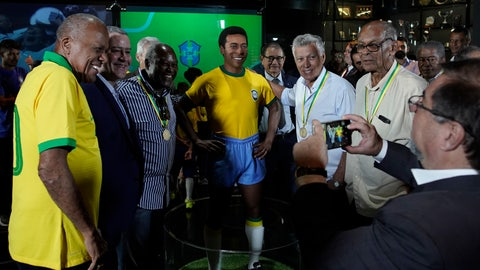 <p>               Former Brazilian soccer legends, from left, Dario, Rogerio Caboclo (the president of the Brazilian Football Confederation ), Edu, Clodoaldo and Brito. pose for a photo with a statue of soccer legend Pele at the Brazilian Soccer Team Museum in Rio de Janeiro, Brazil, Thursday, Feb. 20, 2020. The Brazilian Football Confederation unveiled the statue as part of commemorations of 50 years since the World Cup victory in 1970. (AP Photo/Leo Correa)             </p>