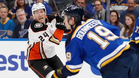 <p>               St. Louis Blues' Jay Bouwmeester (19) handles the puck as Anaheim Ducks' Carter Rowney (24) defends during the first period of an NHL hockey game Monday, Jan. 13, 2020, in St. Louis. (AP Photo/Jeff Roberson)             </p>