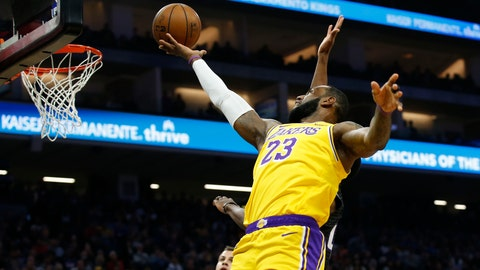 <p>               Los Angeles Lakers forward LeBron James goes to the basket against the Sacramento Kings during the first quarter of an NBA basketball game in Sacramento, Calif., Saturday, Feb. 1, 2020. (AP Photo/Rich Pedroncelli)             </p>