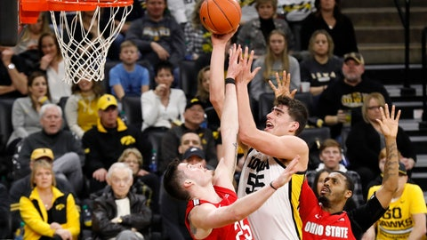 <p>               Iowa center Luka Garza (55) drives to the basket between Ohio State's Kyle Young, left, and Luther Muhammad, right, during the second half of an NCAA college basketball game, Thursday, Feb. 20, 2020, in Iowa City, Iowa. Iowa won 85-76. (AP Photo/Charlie Neibergall)             </p>