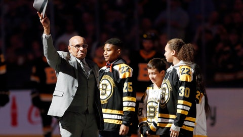 <p>               Hockey Hall of Famer Willie O'Ree, right, waves to the crowd before dropping the ceremonial puck before an NHL hockey game between the Boston Bruins and the Edmonton Oilers in Boston, Saturday, Jan. 4, 2020. (AP Photo/Michael Dwyer)             </p>